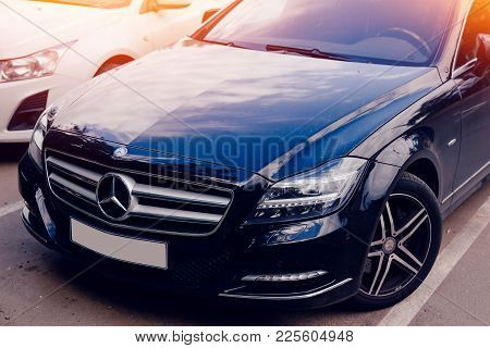 Moscow, Russia - June 12, 2017: Black Mercedes Benz On Street Toned With Glare Of Sun