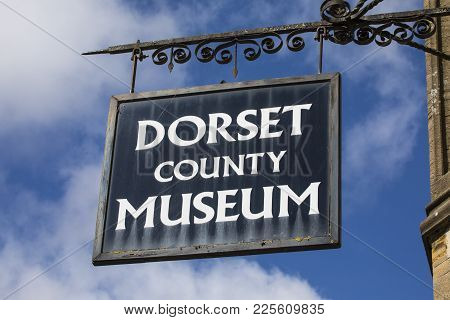 Dorchester, Uk - August 15th 2017: The Sign Above The Entrance To The Dorset County Museum Located O