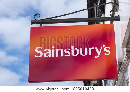 Dorset, Uk - August 16th 2017: A Sign For A Sainsburys Supermarket Store In The Town Of Wareham In D