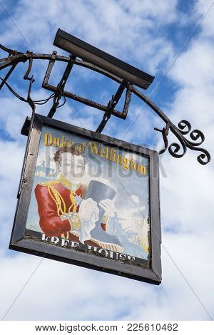 Wareham, Uk - August 16th 2017: The Traditional Pub Sign Hanging Outside The Duke Of Wellington Publ