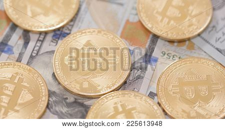 Stack of USD and bitcoin