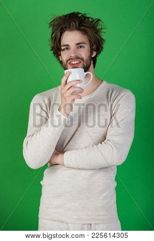 Man With Disheveled Hair Drink Mulled Wine. Morning With Coffee Or Milk. Insomnia, Refreshment And E