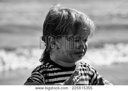 Cute Unhappy Baby Boy With Dirty Face And Hair, Blond, In Blue Striped Tshirt Crying On Sunny Summer