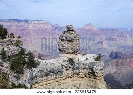 The Duck On A Rock Formation With The South Rim In The Background