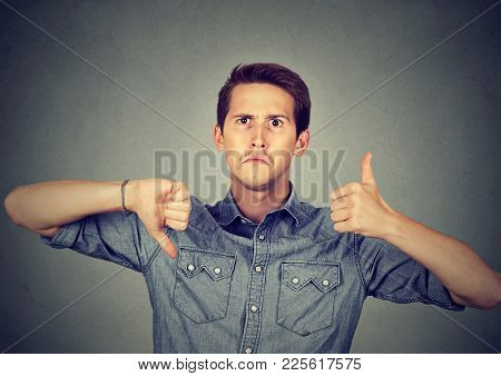 Perplexed Man With Thumbs Down Thumbs Up Gesture