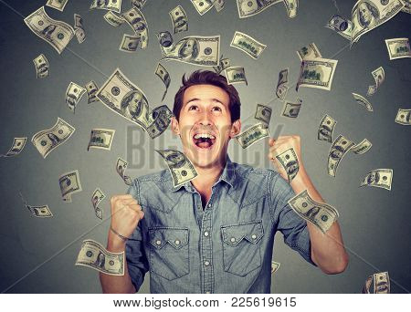 Happy Young Man Screaming Super Excited. Portrait Ecstatic Guy Celebrates Success Under Money Rain F