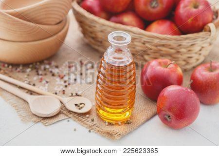 bottle of Apple cider vinegar with fresh fruits - food and drink