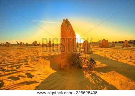 Giant Limestone Formation Illuminated By Red Sunset Light. Pinnacles Desert In Nambung National Park