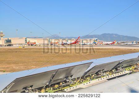 Palma, Mallorca, Spain On July 11, 2014: Landing Breaks. Airline Wing With Landing Break Mechanics O