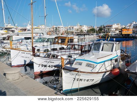 Palma, Mallorca, Spain On July 15, 2014:  Small Boats In Cala Ratjada Harbor On A Sunny Summer Morni