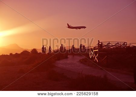 Can Pastilla, Majorca - July 21, 2014: People Airplane Spotting In Golden Red Sunset Skies On A Sunn