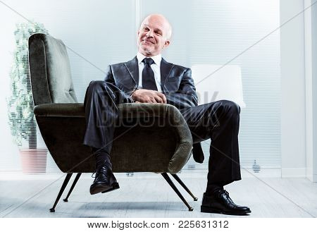 Relaxed Businessman With A Satisfied Smile
