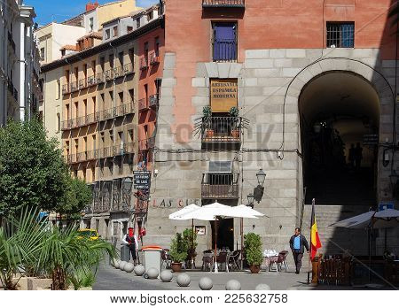 Cuchilleros Street (calle) And Arch (arco), One Of The Ten Entrances To The Main Square (plaza Mayor
