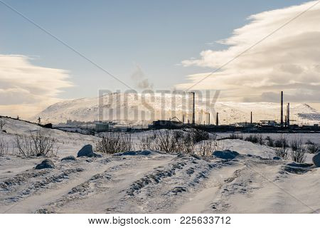 Snow-covered Field In The Background Of High Mountains