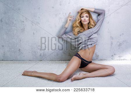 Fashionable Blonde Beautiful Woman Posing.