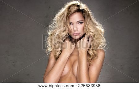 Blonde Beautiful Woman With Long Hair.