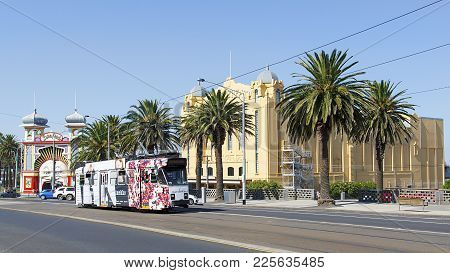 Melbourne, Australia: April 04, 2017: A Tram Leaves Acland Street And Travels Past Luna Park In St K