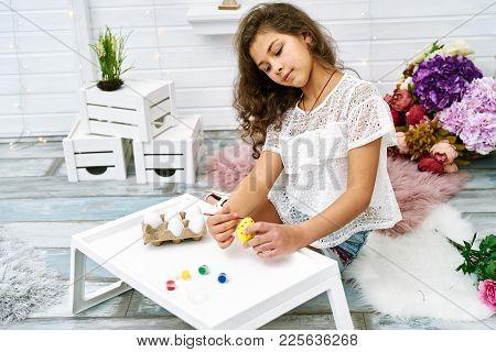 Ten Years Girl Painting Eggs For Easter