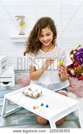 Beautiful Ten Years Girl Painting Eggs For Easter