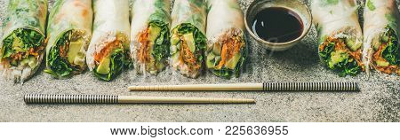 Helathy Asian Cuisine. Vegan Spring Rice Paper Rolls With Vegetables, Soy Sauce, Chopsticks Over Con