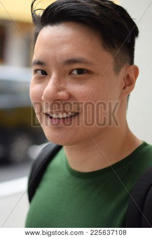 A Young Handsome Asian Chinese Man Smiling Outdoor