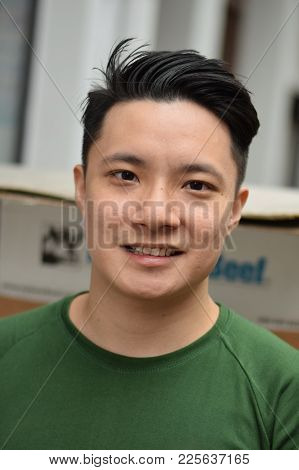 A Happy Handsome Looking Asian Chinese Man Smiling