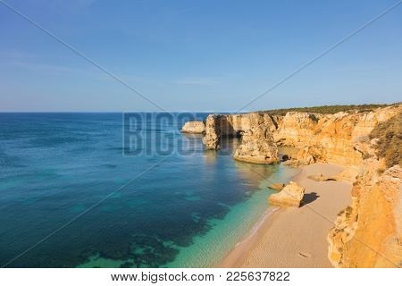 Top view of idyllic beach of Marinha, Algarve Portugal