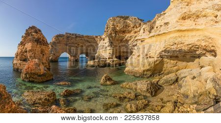 Panoramic image of natural caves at Marinha beach, Algarve Portugal