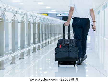 Businessman Wolking On Walkway In Airport.businessman Going Abroad For Meeting And Business Deal. Af