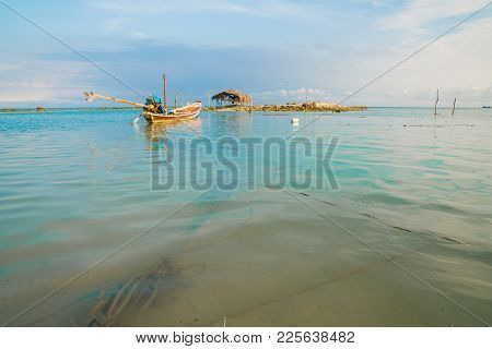 Traditional Asian Long Tail Fishing Boats Moored At Bang Kao Beach, Koh Samuui, Thailand.