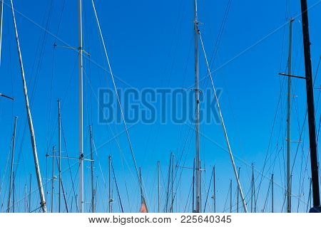 Abstract Background Of Yacht Masts With Sky On The Background