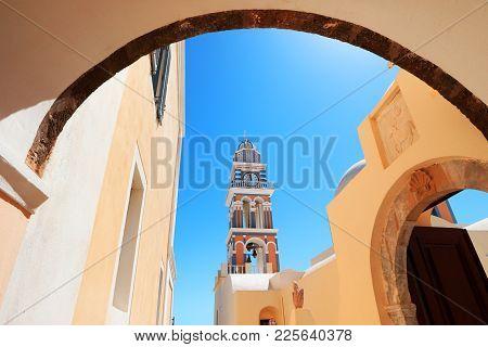 Fira Town Church Clock Tower Framed By An Arch Way.santorini Island Cyclades In Greece.