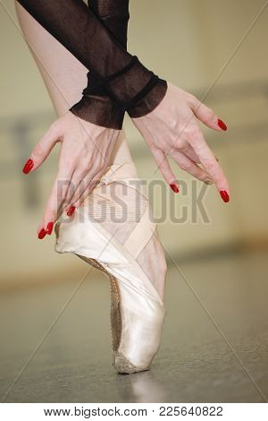 Foot Ballerina In Pointe Shoes. Beautiful Graceful Hands. Rehearsal Of The Dance. Shooting Close-ups