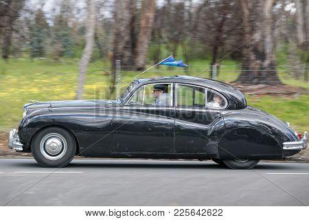 Adelaide, Australia - September 25, 2016: Vintage 1955 Jaguar Mk Vii M Saloon Driving On Country Roa