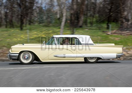 Adelaide, Australia - September 25, 2016: Vintage 1959 Ford Thunderbird Coupe Driving On Country Roa
