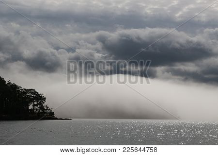 Huge Fog Bank Rolls In From Haro Strait In The San Juan Islands In Puget Sound, Washington State, Us