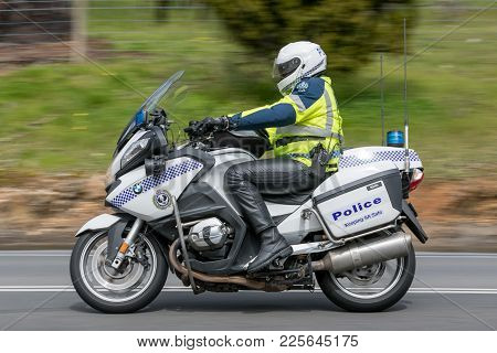 Adelaide, Australia - September 25, 2016: South Australian Police Officer Riding A Bwm Police Motorc