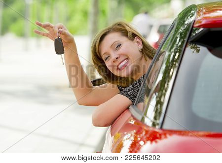 Young Happy Attractive Woman Smiling Proud Sitting At Driver Seat Holding And Showing Car Key In New