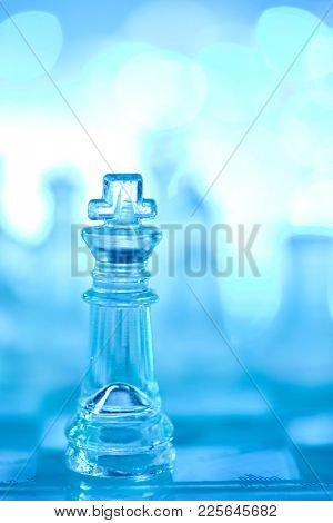 glass chess on blue background