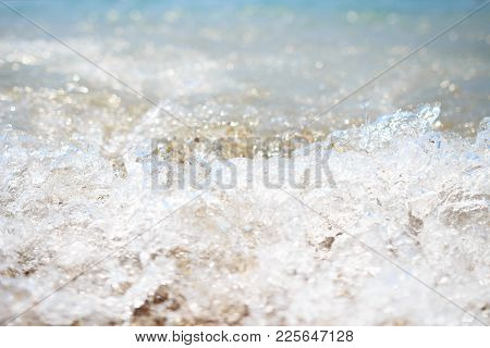 Splashes And Waves On The Sea Shore Close-up. Seawater Is Boiling. Water Element Background. Structu
