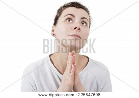 Young Brunette Woman Praying To God And Palms Together In Front Of Face Isolated On White Background