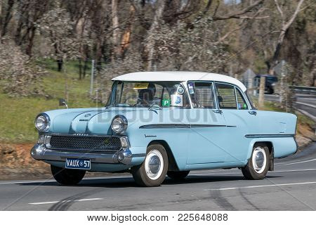 Adelaide, Australia - September 25, 2016: Vintage 1957 Vauxhall Victor Sedan  Driving On Country Roa
