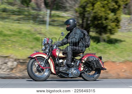 Adelaide, Australia - September 25, 2016: Vintage 1942 Harley Davidson WL Motorcycle on country roads near the town of Birdwood, South Australia.