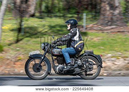 Adelaide, Australia - September 25, 2016: Vintage BSA Motorcycle on country roads near the town of Birdwood, South Australia.