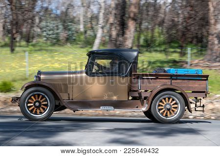 Adelaide, Australia - September 25, 2016: Vintage 1925 Dodge 4 Utility driving on country roads near the town of Birdwood, South Australia.