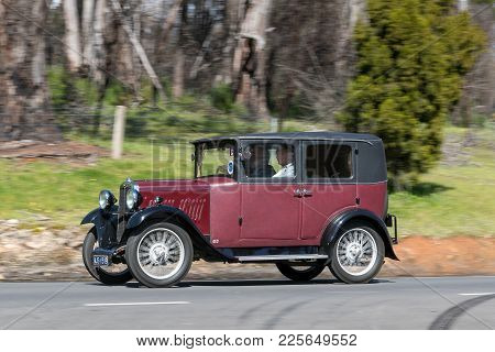 Adelaide, Australia - September 25, 2016: Vintage 1930 AJS AJS9 Fabric Saloon driving on country roads near the town of Birdwood, South Australia.