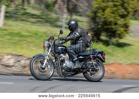 Adelaide, Australia - September 25, 2016: Vintage Kawasaki Motorcycle on country roads near the town of Birdwood, South Australia.