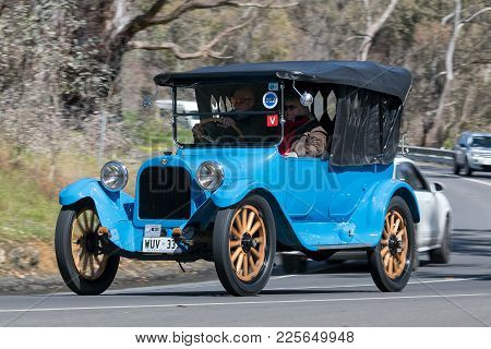 Adelaide, Australia - September 25, 2016: Vintage 1916 Dodge Tourer driving on country roads near the town of Birdwood, South Australia.