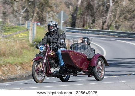 Adelaide, Australia - September 25, 2016: Vintage 1954 Ariel VH Motorcycle with sidecar on country roads near the town of Birdwood, South Australia.