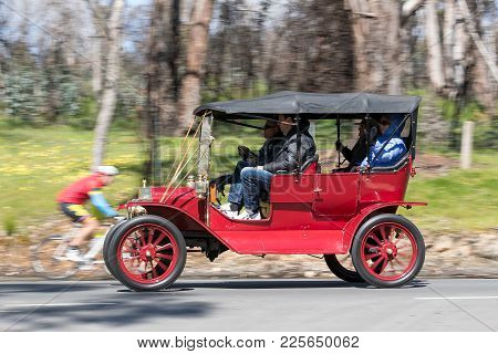 Adelaide, Australia - September 25, 2016: Vintage 1911 Ford Model T Tourer driving on country roads near the town of Birdwood, South Australia.